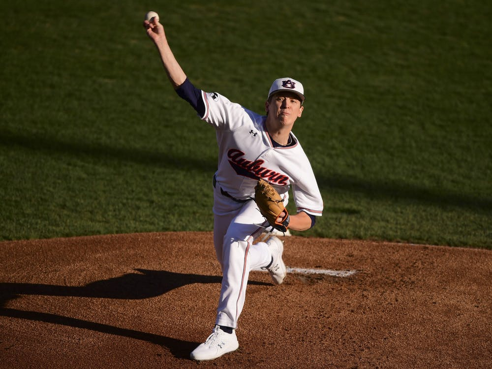 Feb 23, 2021; Auburn, AL, USA; Auburn Tigers pitcher Trace Bright (21) delivers during the game between Auburn and Alabama A&M at Plainsman Park. Mandatory Credit: Shanna Lockwood/AU Athletics