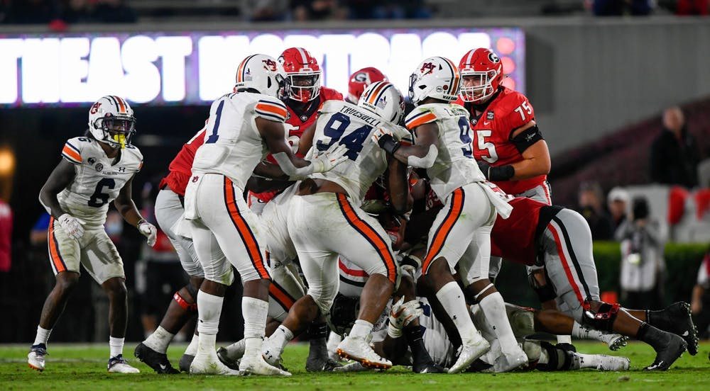 Oct 3, 2020; Athens, GA, USA; Defensive line stopping the run during in the second half between Auburn and Georgia at Samford Stadium. Mandatory Credit: Todd Van Emst/AU Athletics