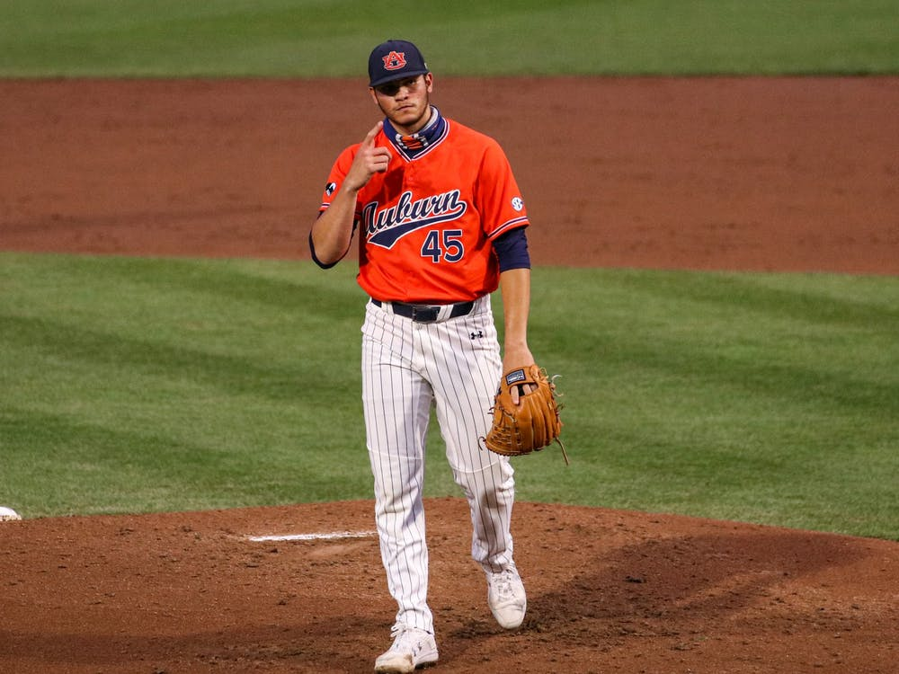 Mar 27, 2021; Auburn, AL, USA; Auburn Tigers pitcher Joseph Gonzalez (45) reacts after a play during the game between Auburn and Kentucky at Plainsman Park. Mandatory Credit: Jacob Taylor/AU Athletics
