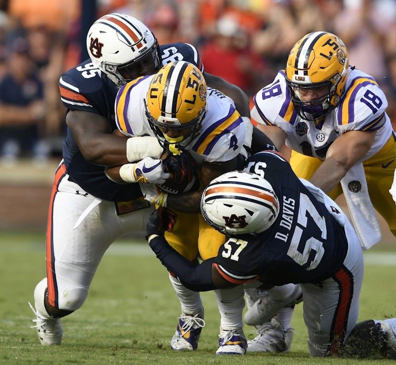 Auburn's Dontavious Russell and Deshaun Davis tackle Nick Brossette.LSU at Auburn football on Saturday, Sept. 15, 2018 in Auburn, Ala.Todd Van Emst/AU Athletics