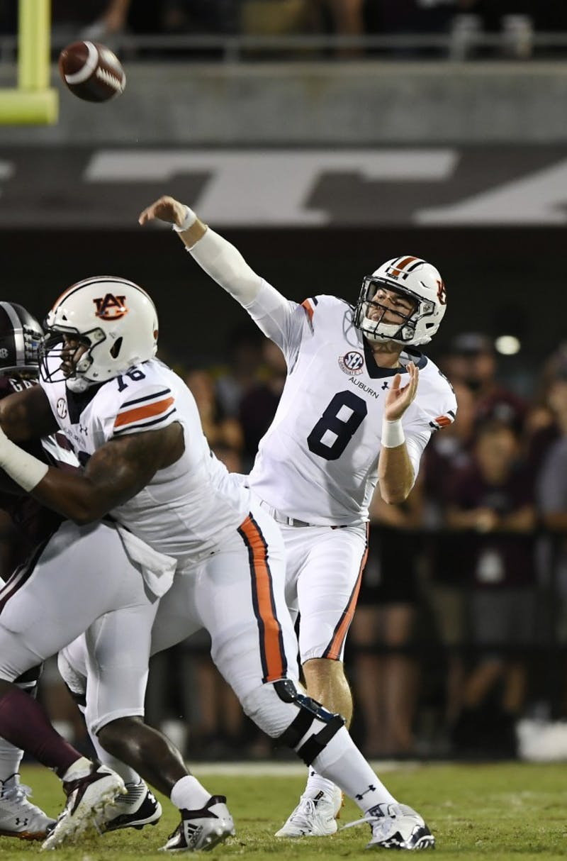 Jarrett Stidham makes a throw in the first half.