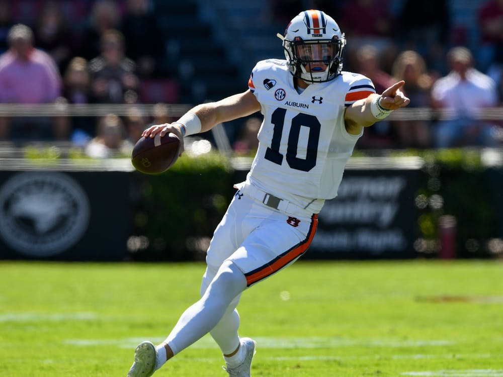 Oct 3, 2020; Columbia, SC, USA; Bo Nix (10) directing blocking while running for the first down during the game between Auburn and South Carolina at Williams-Brice Stadium. Mandatory Credit: Todd Van Emst/AU Athletics