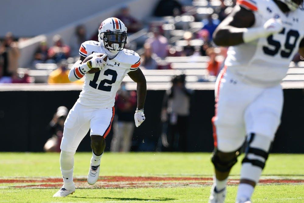 Oct 14, 2020; Columbia, SC, USA; Eli Stove (12) runs during the game between Auburn and South Carolina at Williams-Brice Stadium. Mandatory Credit: Todd Van Emst/AU Athletics