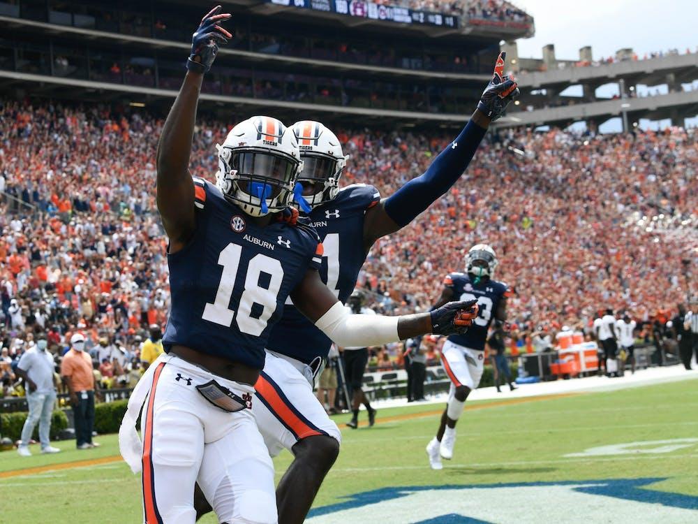 Sep 11, 2021; Auburn, AL, USA; Dematrius Davis (18) celebrates between Auburn and Alabama State at Jordan-Hare Stadium. Mandatory Credit: Todd Van Emst/AU Athletics