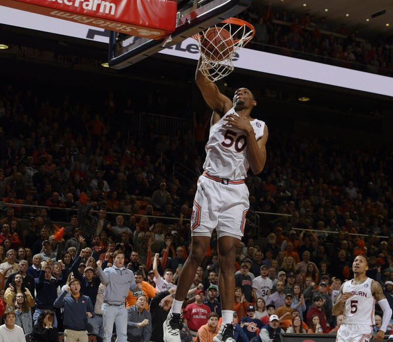 Auburn's Austin Wiley gets a dunk in the second half to put Auburn up fpr good in te second half.
