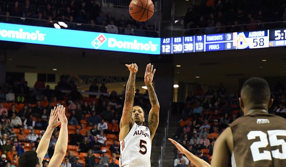 Auburn's J'Von McCormick (5) shoots a three pointer in the second half.   Auburn Mens Basketball vs Lehigh on Saturday, December 21, 2019 in Auburn, Ala.  Anthony Hall/Auburn Athletics