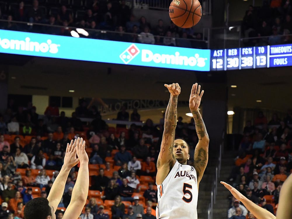 Auburn's J'Von McCormick (5) shoots a three pointer in the second half.   Auburn Mens Basketball vs Lehigh on Saturday, December 21, 2019 in Auburn, Ala.  Anthony Hall/Auburn Athletics