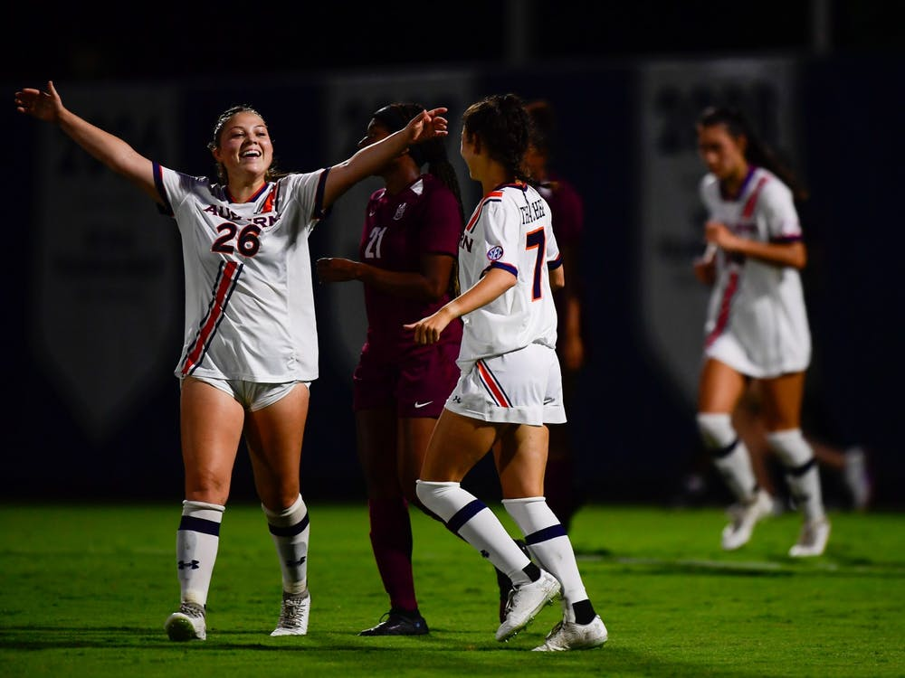 Sep 9, 2021; Auburn, AL, USA; Grace Sklopan (26) embraces Carly Thatcher (7) after she scores a goal during the game between Auburn and Alabama A&M at Auburn Soccer Complex. Mandatory Credit: Matthew Shannon/AU Athletics