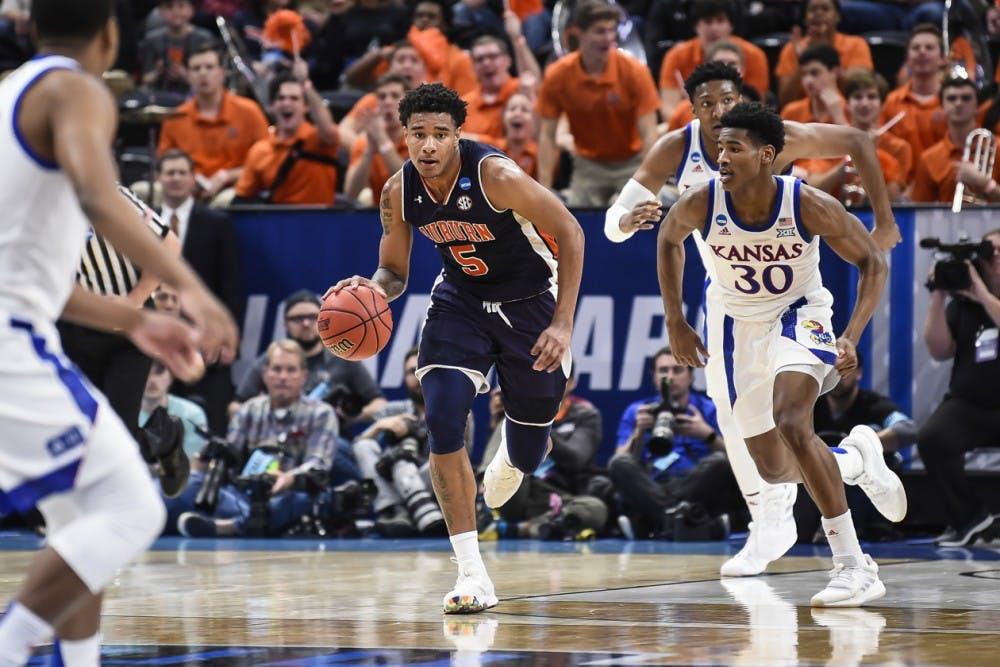 <p>Chuma Okeke (5)</p> <p>Auburn men's basketball vs Kansas during the second round of the NCAA Tournament on Saturday, March 23, 2019, in Salt Lake City, Utah.&nbsp;</p> <p>Photo: Wade Rackley /Auburn Athletics</p>