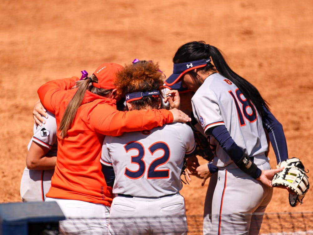 Feb 19, 2021; Auburn, AL, USA; Team meeting during the game between Auburn and Arkansas at Jane B. Moore Field . Mandatory Credit: Jacob Taylor/AU Athletics