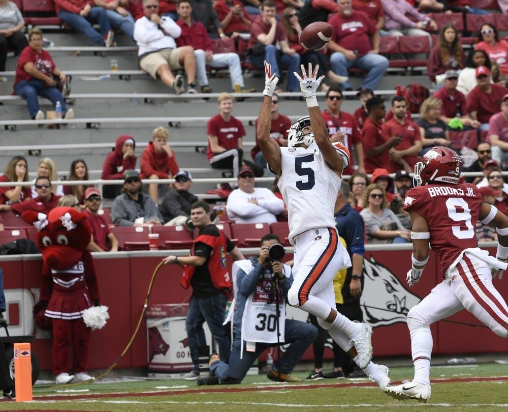 Auburn's Anthiny Schwartz scores in the second half.Auburn football vs Arkansas on Saturday, Oct. 19, 2019 in Fayetteville, AK.Todd Van Emst/AU Athletics