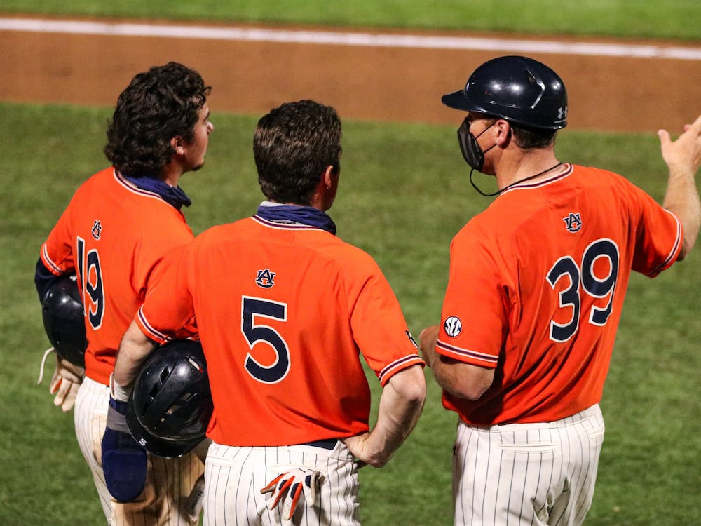 Mar 27, 2021; Auburn, AL, USA; The coach talks to Brody Moore and Kason Howell during the game between Auburn and Kentucky at Plainsman Park. Mandatory Credit: Jacob Taylor/AU Athletics