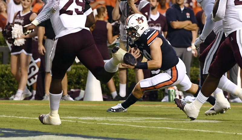 Bo Nix (10) scores a touchdown in the first half.