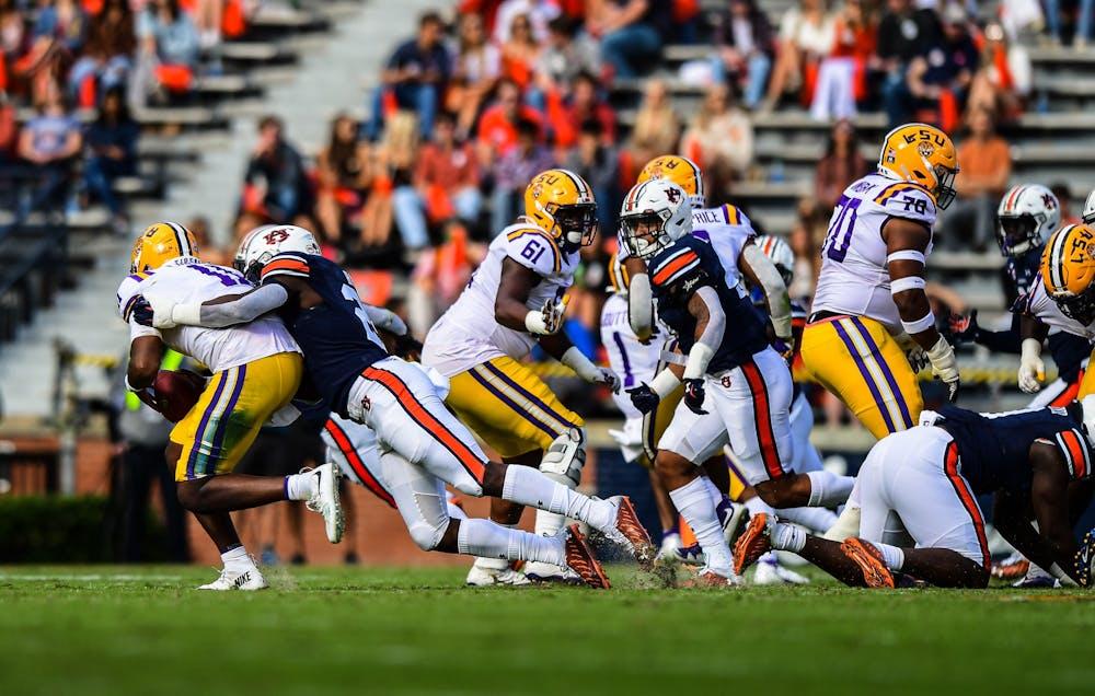 Oct 3, 2020; Auburn AL, USA; Derick Hall (29) gets a down during the game between Auburn and LSU at Jordan Hare Stadium. Mandatory Credit: Shanna Lockwood/AU Athletics