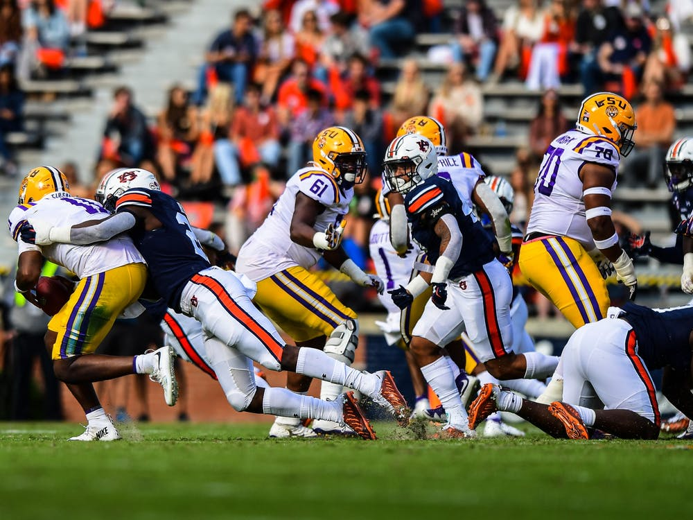 Oct 3, 2020; Auburn AL, USA; Derick Hall (29) gets a down during the game between Auburn and LSU at Jordan Hare Stadium. Mandatory Credit: Shanna Lockwood/AU Athletics