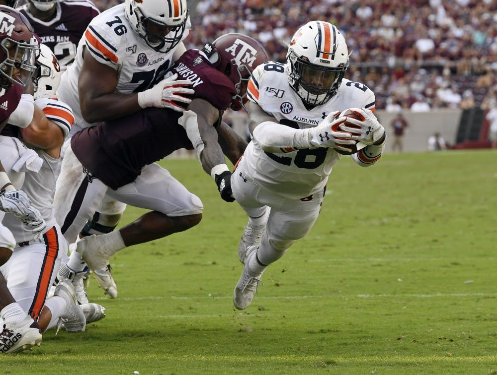 JaTarvious Whitlow (28) scores a touchdown in the second half.Auburn vs Texas A&M on Saturday, Sept. 21, 2019 in College Station, TX.Todd Van Emst/AU Athletics
