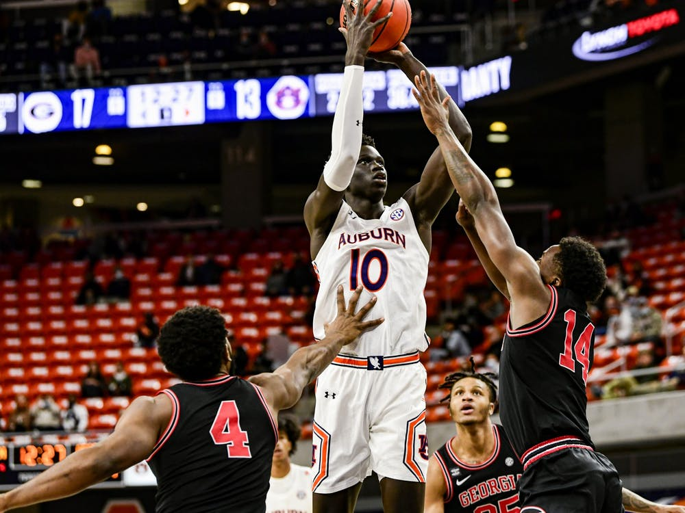 Jan 31, 2021; Auburn, AL, USA; Auburn Tigers forward JT Thor (10) shoots the ball during the game between Auburn and Georgia at Auburn Arena. Mandatory Credit: Todd Van Emst/AU Athletics
