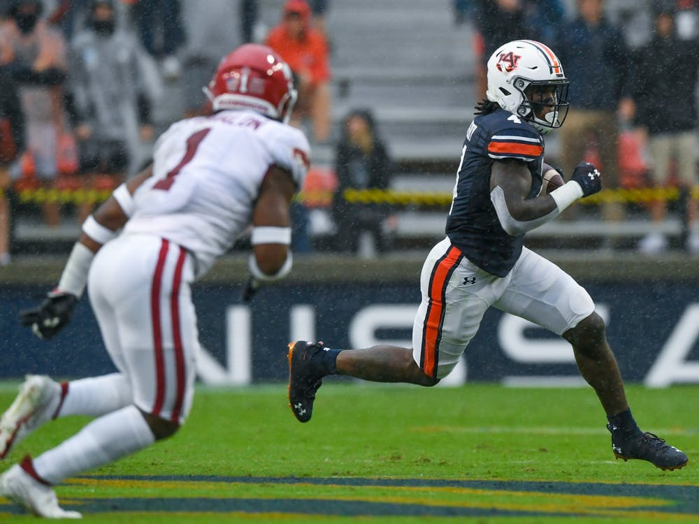 Oct 3, 2020; Auburn, AL, USA; Tank Bigsby (4) rushes for the first down during the game between Auburn and Arkansas at Jordan-Hare Stadium. Mandatory Credit: Todd Van Emst/AU Athletics