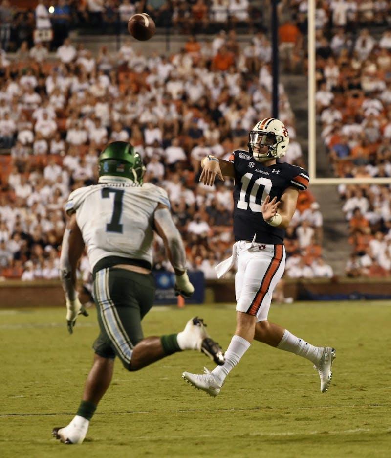 Bo Nix makes a throw Auburn Football Tulane at Auburn on Saturday, Sept. 7, 2019 in Auburn, Ala.