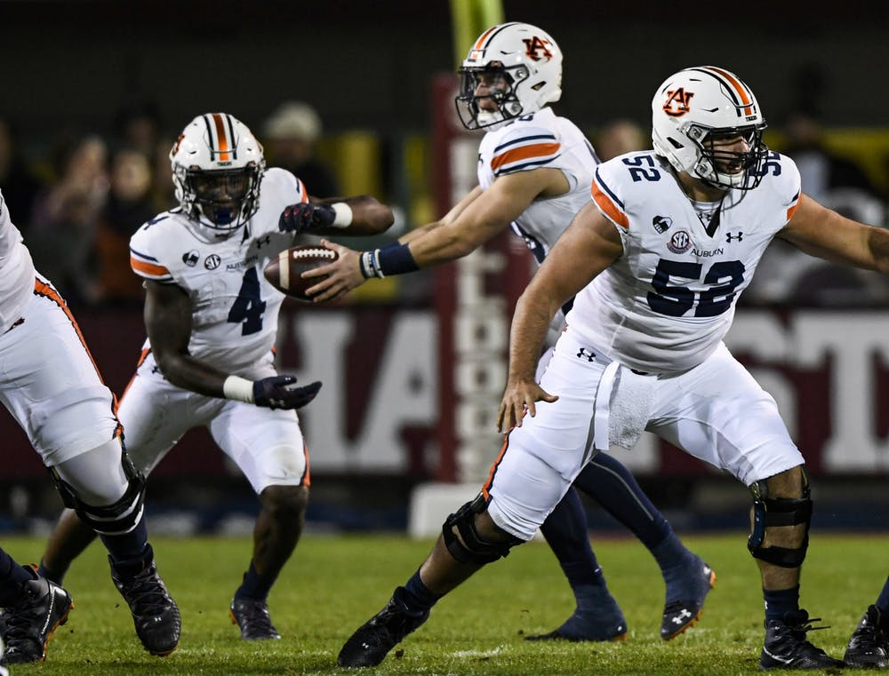 Oct 3, 2020; Starkville, Mississippi, USA; Bo Nix (10) giving ball to Tank Bigsby (4) during the game between Auburn and Mississippi State at Davis Wade Stadium. Mandatory Credit: Todd Van Emst/AU Athletics