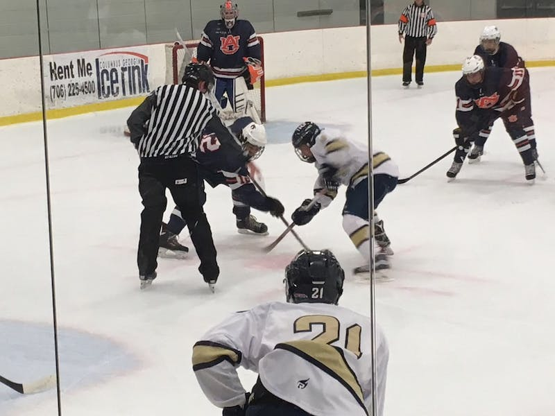 The Tigers square up for a defensive face-off midway through the first period.