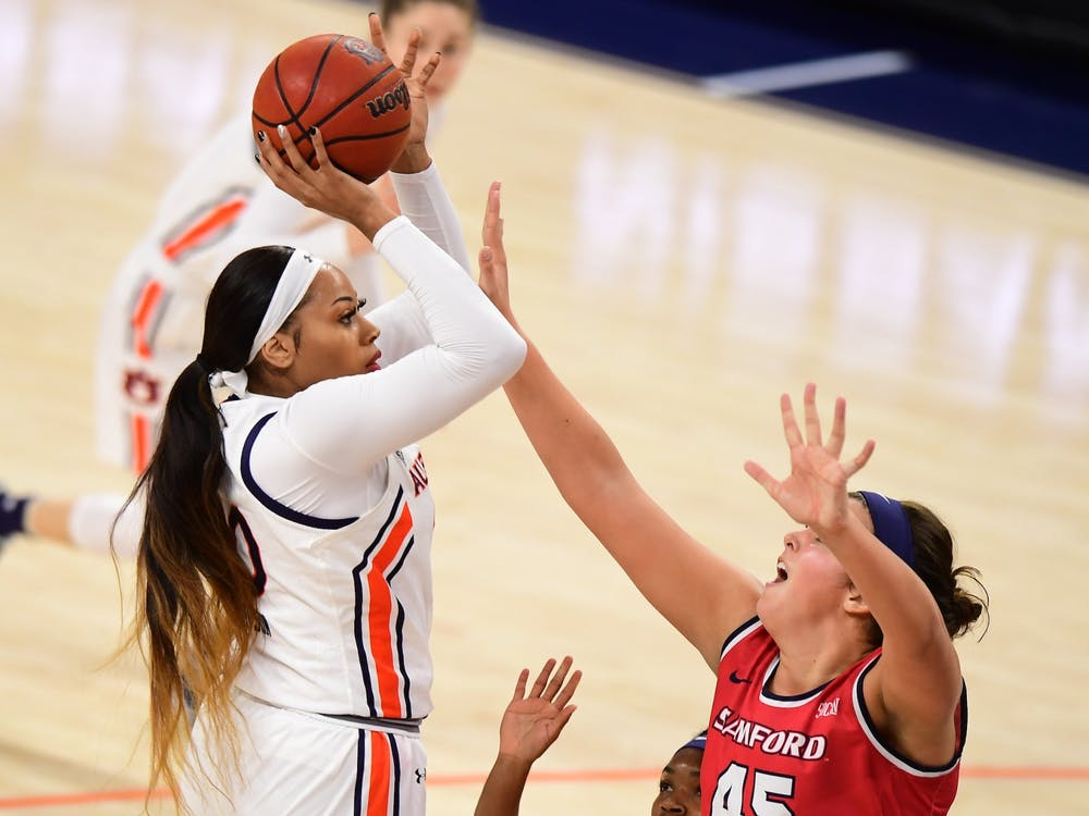 Nov 28, 2020; Auburn, AL, USA; Unique Thompson (20) shoots over Natalie Armstrong (45) during the game between Auburn and Samford at Auburn Arena. Mandatory Credit: Shanna Lockwood/AU Athletics
