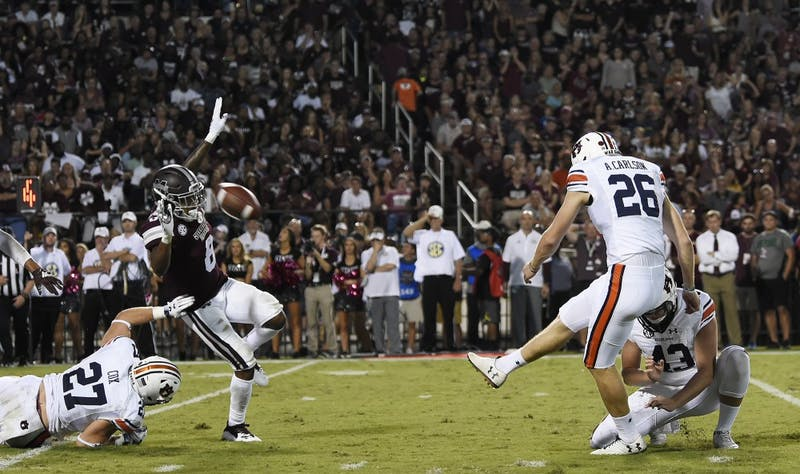 Anders Carlson kicks a field goal in the second half.