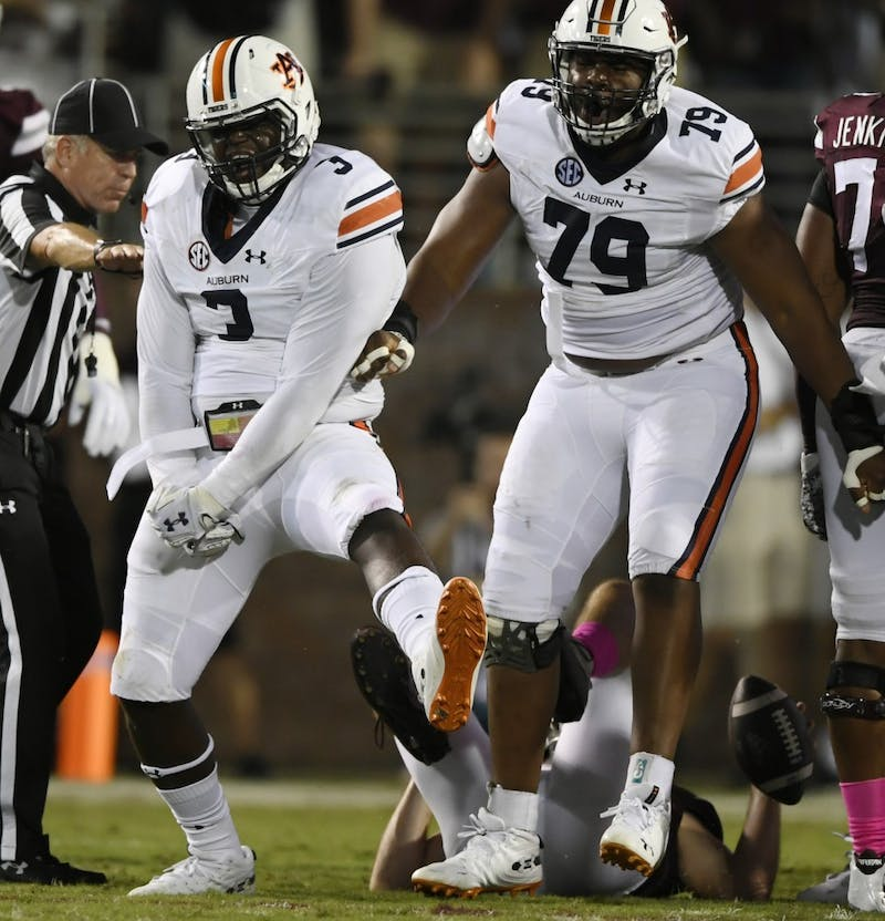 Auburn defenders Marlon Davidson celebrates tackling Nick Fitzgerald for a loss.