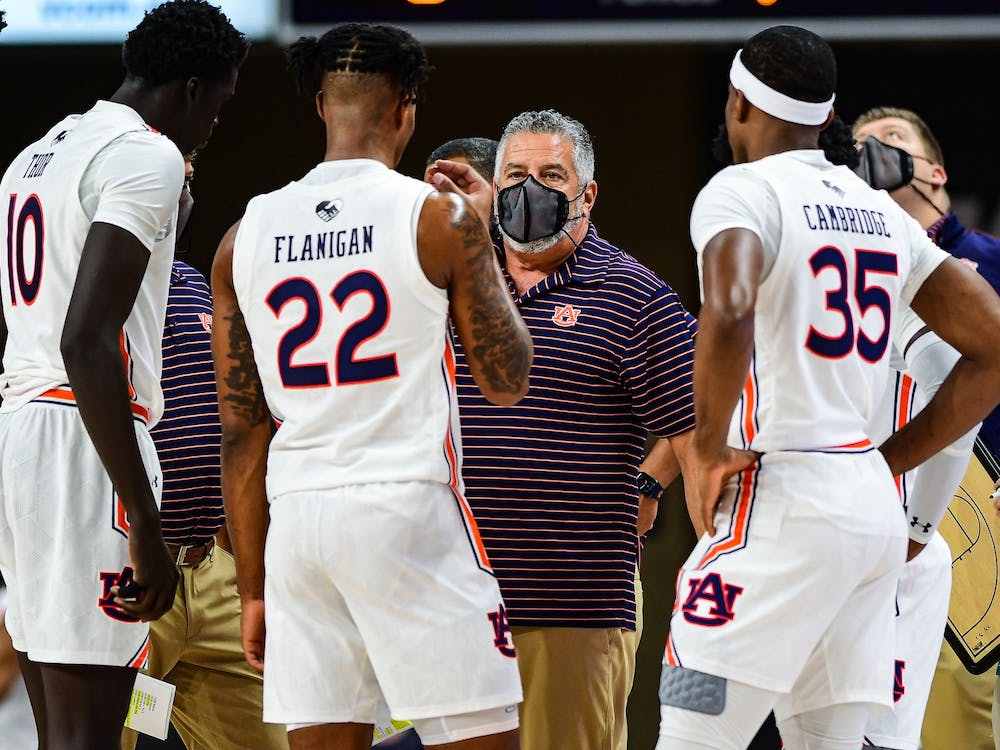 Dec 4, 2020; Auburn, AL, USA; Bruce Pearl talks to the team during during the game between Auburn and South Alabama at Auburn Arena. Mandatory Credit: Shanna Lockwood/AU Athletics