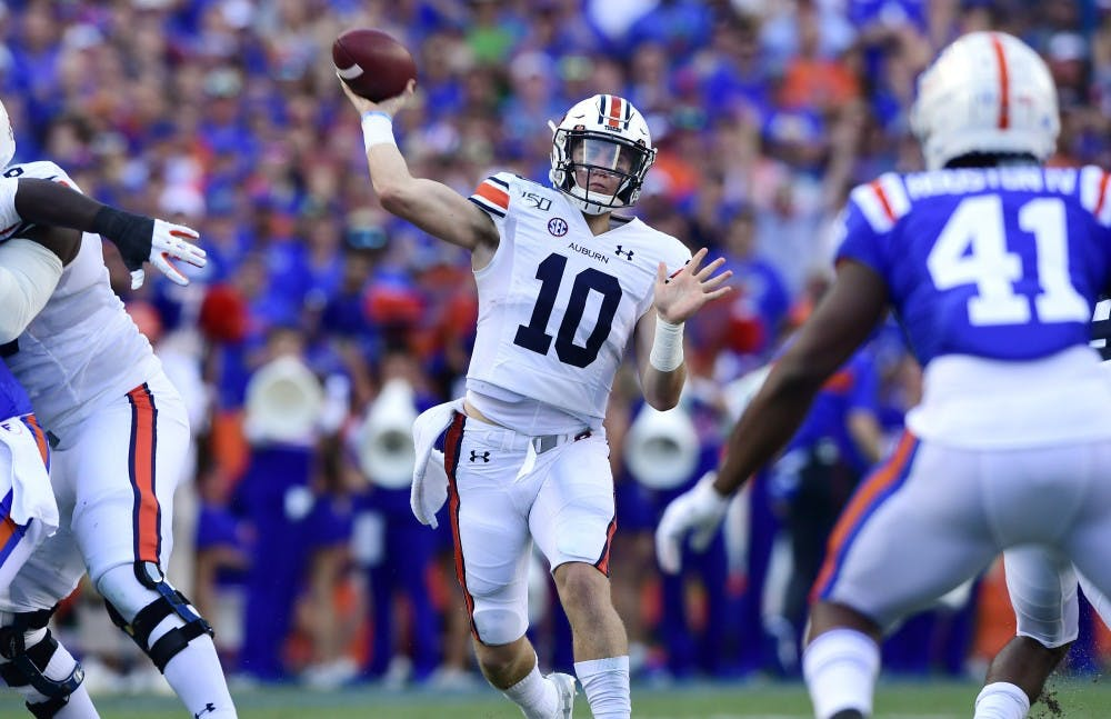 Bo Nix (10) throws a touchdown in the first half.Auburn football at Florida on Saturday, Oct. 5, 2019 in Gainesville, FLTodd Van Emst/AU Athletics