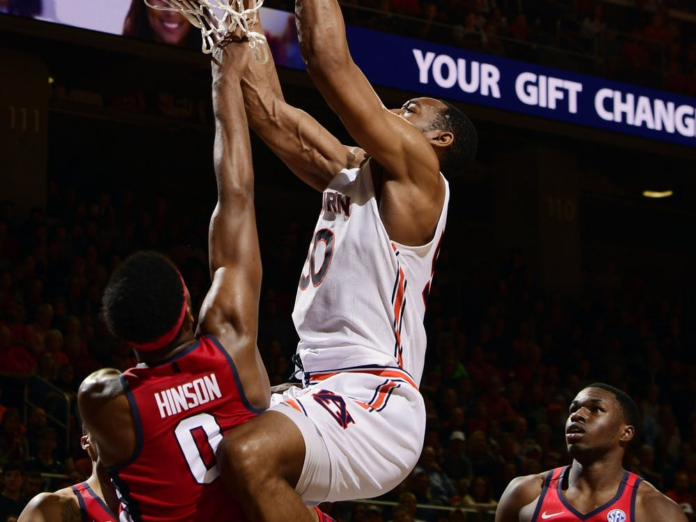 Auburn center Austin Wiley (50) gets a dunk in the second half.AU MBB v Ole Miss  on Tuesday, Feb. 25, 2020 in Auburn, Ala. Todd Van Emst