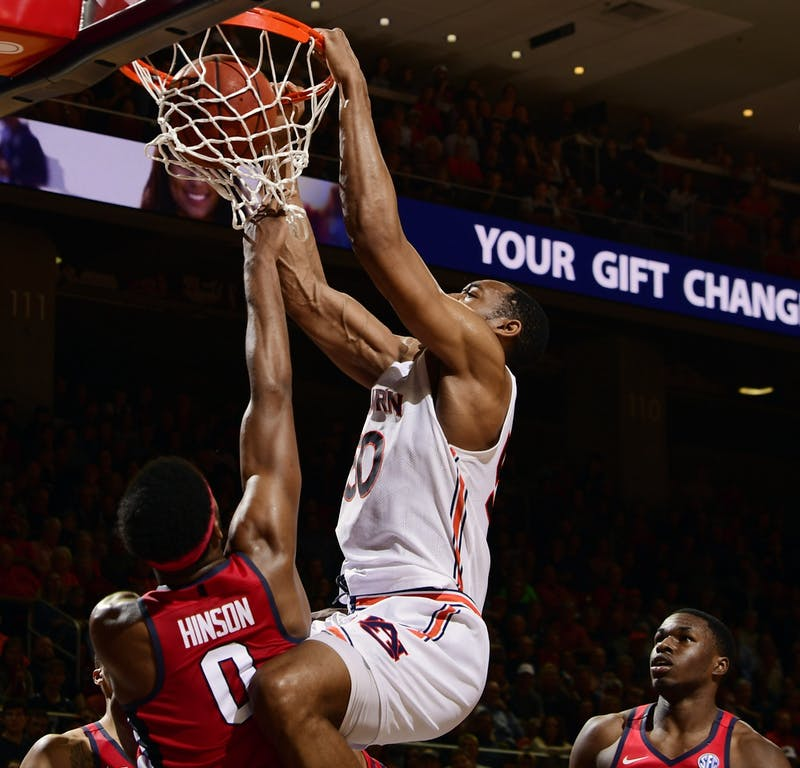 Auburn center Austin Wiley (50) gets a dunk in the second half.