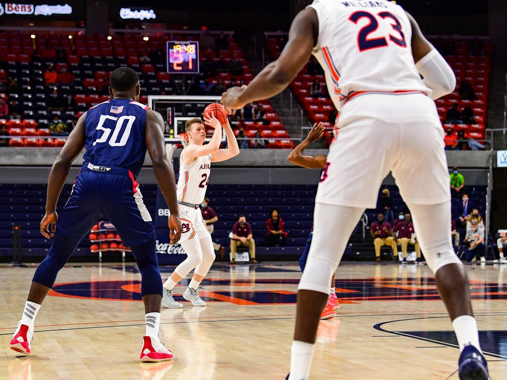 Dec 4, 2020; Auburn, AL, USA; Justin Powell (24) goes for a three during during the game between Auburn and South Alabama at Auburn Arena. Mandatory Credit: Shanna Lockwood/AU Athletics