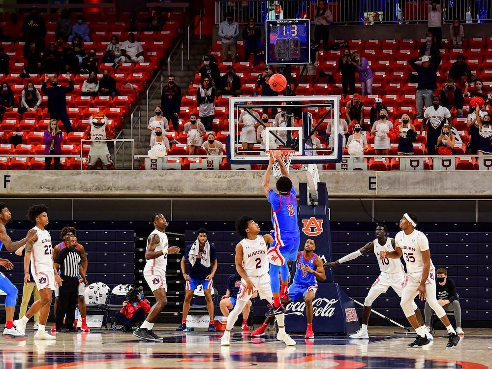 Feb 6, 2021; Auburn, AL, USA; Mississippi Rebels guard Devontae Shuler (2) shoots buzzerbeater during the game between Auburn and Ole Miss at Auburn Arena. Mandatory Credit: Shanna Lockwood/AU Athletics