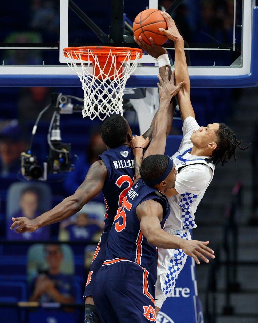 Kentucky's Brandon Boston Jr. is blocked by Auburn's Jaylin Williams in the second half as Kentucky defeated Auburn 82-80 on February 13, 2021.  Photo by Elliott Hess | UK Athletics