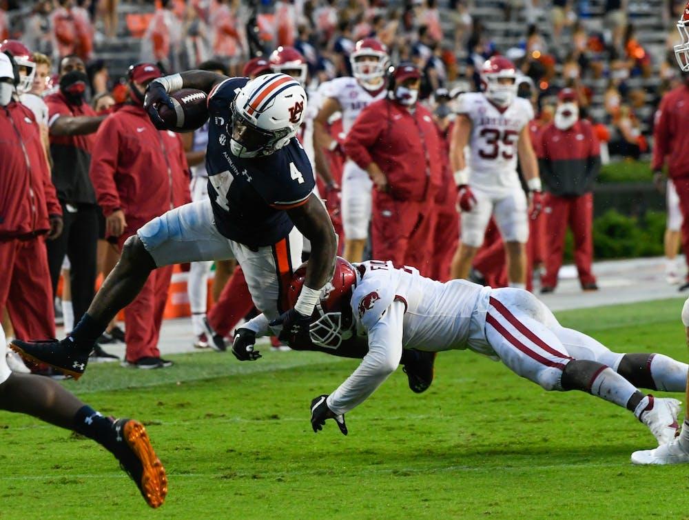 Oct 3, 2020; Auburn, AL, USA; Tank Bigsby (4) rushes the ball during the second half between Auburn and Arkansas at Jordan-Hare Stadium. Mandatory Credit: Todd Van Emst/AU Athletics
