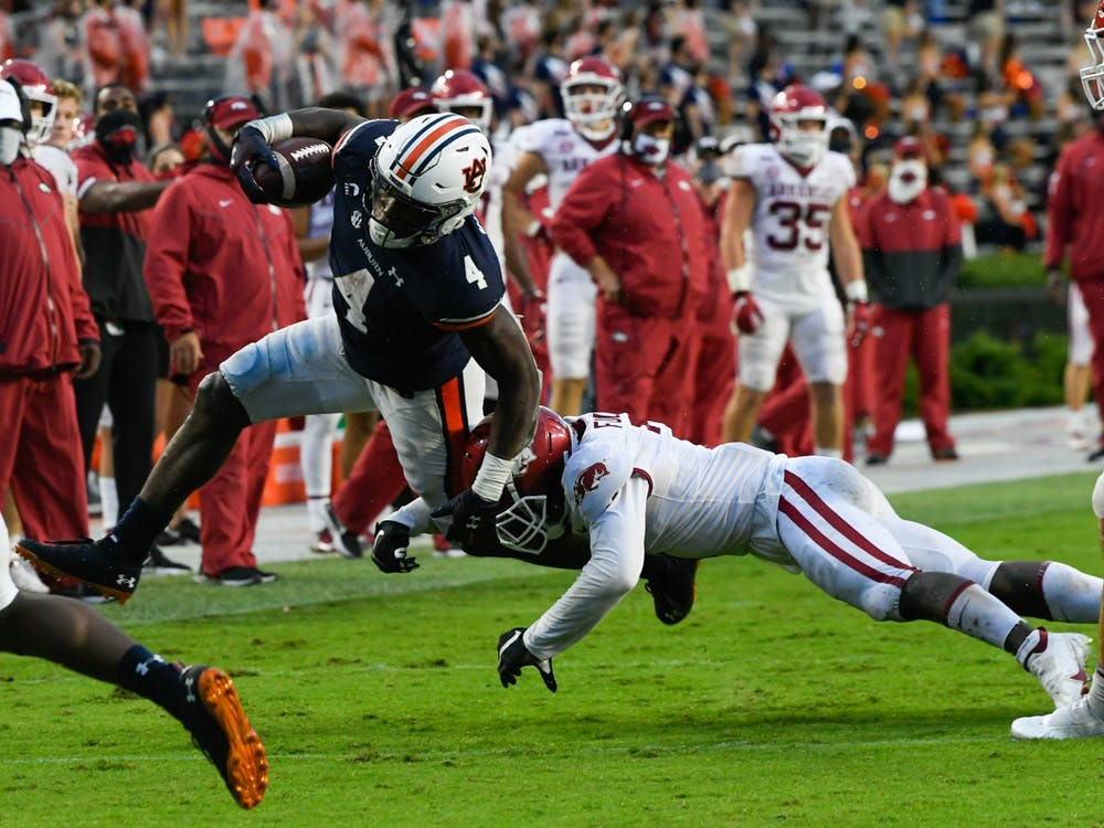 Oct 3, 2020; Auburn, AL, USA; Tank Bigsby (4) rushes the ball during the second half between Auburn and Arkansas at Jordan-Hare Stadium. Mandatory Credit: Todd Van Emst/AU Athletics