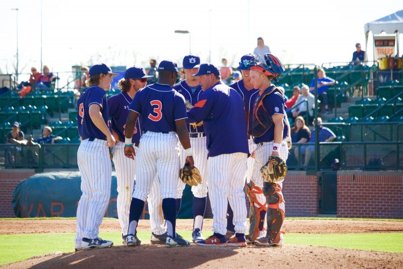 Head Coach Butch Thompson speaks toinfieldersduring timeout during the Auburn vs. Presbyterian game on Friday, March 10, 2017 in Auburn. Ala.