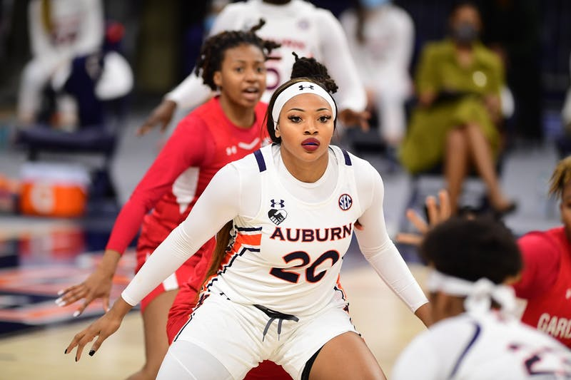 Dec 1, 2020; Auburn, AL, USA; Unique Thompson (20) defends during the game between Auburn and Gardner-Webb at Auburn Arena. Mandatory Credit: Shanna Lockwood/AU Athletics