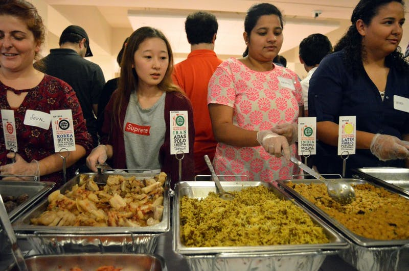 Volunteers serve food during the International Peace Dinner hosted by the International Student Organization in the Student Center on Oct. 28.