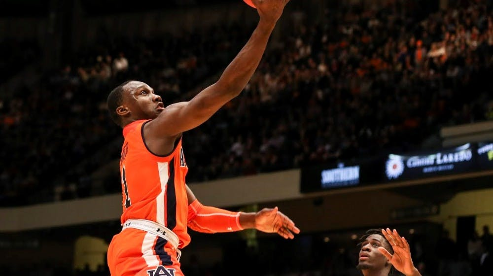 Jared Harper's heroics lead No. 8 Auburn to OT win over UAB