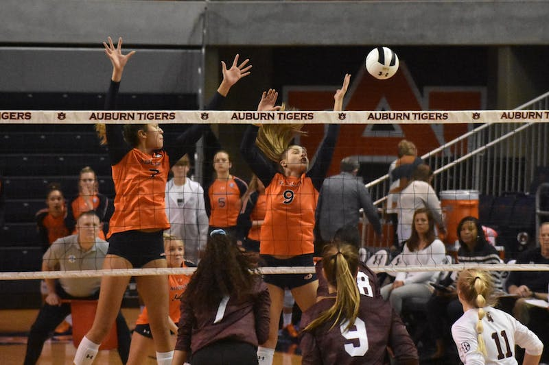 Auburn players Chesney McClellan (7) and Lily Thomason (9) jump to hit the ball at the Auburn v. Mississippi Volleyball Game in Auburn, Al on November 1st.