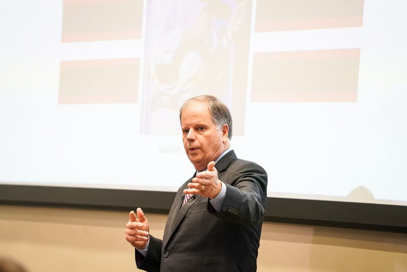 Alabama Sen. Doug Jones speaks at an open candidate forum on Oct. 28, 2020, in Auburn, Ala.