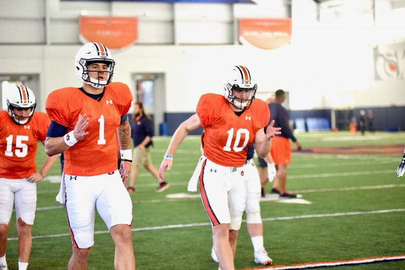 Joey Gatewood (1) and Bo Nix (10) stretch during an open practice on Wednesday, March 27 , 2019, in Auburn, Ala.
