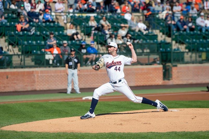 Jack Owen (44) throws the pitch during Auburn Baseball vs UCF on Saturday, Feb. 22, 2020, in Auburn, Ala.