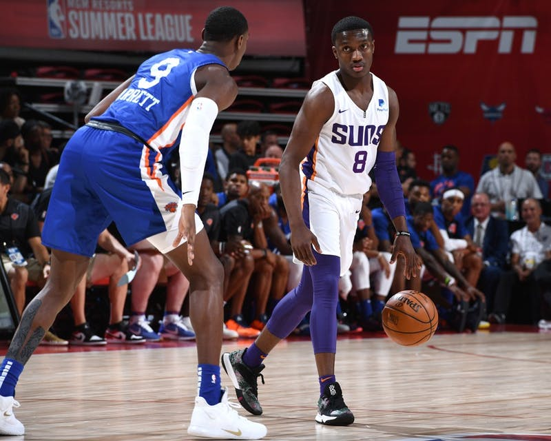 LAS VEGAS, NV - JULY 7: Jared Harper #8 of the Phoenix Suns handles the ball against the New York Knicks during Day 3 of the 2019 Las Vegas Summer League on July 7, 2019 at the Thomas & Mack Center in Las Vegas, Nevada.