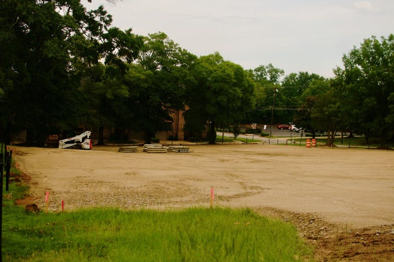 A new employee parking lot is under construction behind Auburn Bank on Friday, July 13, 2018 in Auburn, Ala.