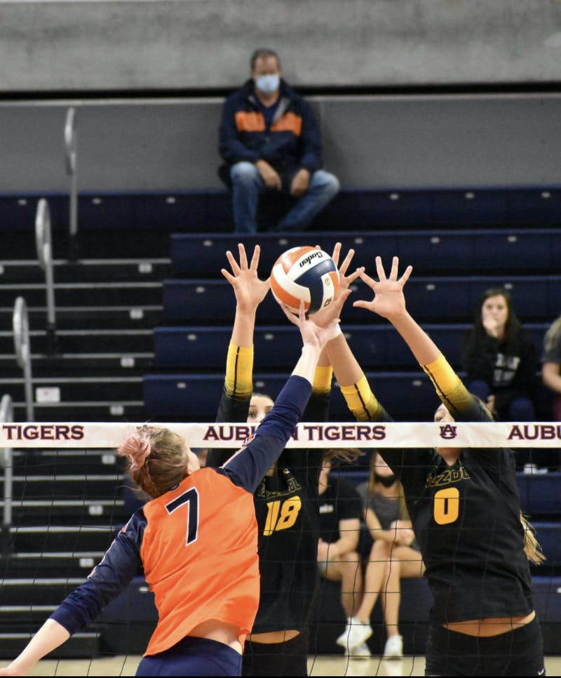 Oct. 16, 2021; Auburn, AL, USA; Rebekah Rath (7) contorts the ball off of her hand in match between Auburn and Missouri in the Auburn Arena.