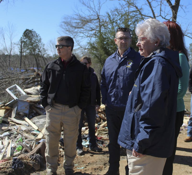 Gov. Kay Ivey looks out at damage surrounding Lee Road 38 during her tour of tornado damage on Wednesday, March 6, 2019, in Beauregard, Ala.