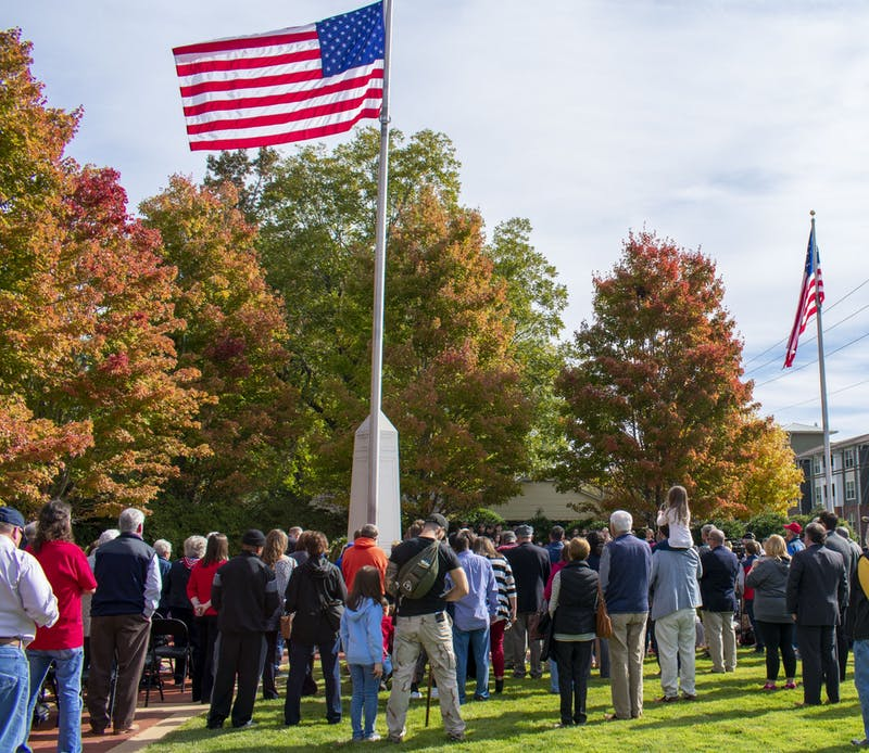 Auburn residents gathered around the flag at the 2019 Veterans Day Ceremony on Nov. 11, 2019.